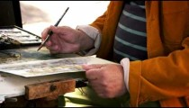 Shot of artist painting using watercolors a scene in Venice.