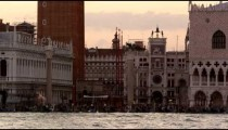 Static shot of Piazza San Marco and waves in the canal.