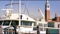 Panning shot of boats at a marina in Venice.