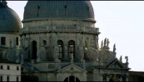 Tight static shot of the architecture of the Basilica of Santa Maria della Salute.