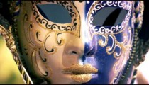 Close up shot of a carnival mask blowing in the wind.