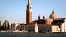 Panning shot of the marina and cathedral at the Island of San Giorgio.