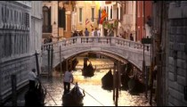 Slow motion shot of gondolas traveling down a canal
