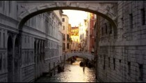Tilt shot of the Bridge of Sighs and the canal beneath it