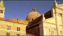 Slow motion shot of the intricate rooftop architecture of the Church of San Giorgio Maggiore.