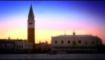 Slow motion shot of the setting sun sky behind Doge's Palace and Marco Tower.