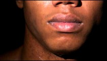 Royalty Free Stock Footage of Close up of a man's sweaty face as he looks at the camera.