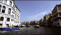 Tracking shot emerging from underneath Rialto Bridge