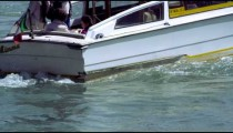 Slow motion shot of a motor boat focusing on the turbulent water created by the propellers