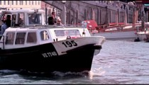 Slow motion footage focusing on a ferry as it navigates up the Grand Canal