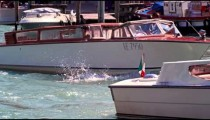 Slow motion shot of boats in venetian canal