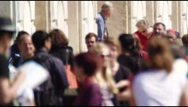 Slow motion shot of a packed waterfront sidewalk in front of the Church of the Scalzi
