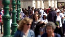 Slow motion shot of crowded walkway in front of the Church of the Scalzi