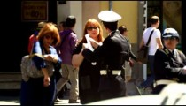 Slow motion footage of a police man talking to two women and gesticulating a lot in Rome, Italy