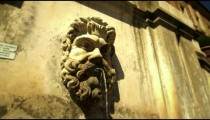 Statue of bearded face wall fountain