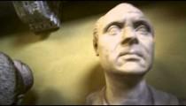 Close tracking shot of head and shoulder sculptures inside Vatican