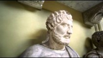 Tracking bust shot influential male sculptures inside Vatican