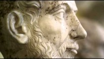 Rack focus footage of roman stone bust sculptures in the Vatican
