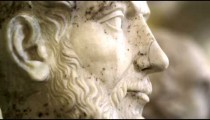 Racking focus shot of roman stone bust sculptures in the Vatican