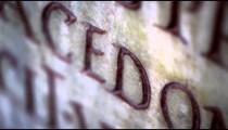 Racking tilt footage of engraved Latin