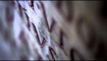 Racking down footage of engraved Latin