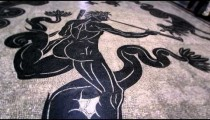Low-angle to high-angle footage of a floor mosaic.
