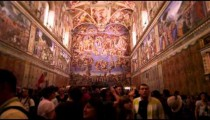 Tourists in the Sistine Chapel