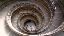 Slow motion descent down large spiral staircase