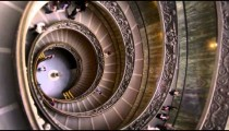 Vertical rotating shot of large spiral staircase in slow motion