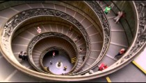 Time-lapse of tourists on large spiral staircase