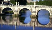 Ponte Sant'Angelo is reflected in the Tiber River