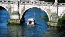 Barge passes under arch of Ponte Sant'Angelo