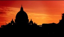 St Peter's Basilica silhouetted against a sunset