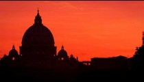 St Peter's Basilica against a pink sunset