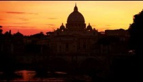 North side of Ponte Sant'Angelo and St Peter's Basilica at sunset