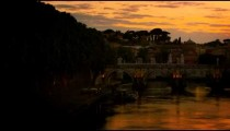 Left-to-right pan of Ponte Sant'Angelo and dome of St. Peter's Basilica at dusk