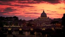Tilt down to St. Peter's Basilica and Ponte Sant'Angelo against blue sunset