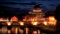 Still footage of Ponte Sant'Angelo and dome of St. Peter's Basilica at night