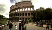 Pedestrians in front of The Colosseum in Rome Italy