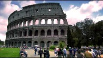 People walking in front of The Colosseum in Rome Italy