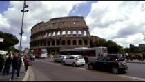 Pedestrians and Traffic in front of the Colosseum in Rome Italy
