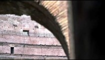 Footage focused on a top corner of an arch in the stands of the Colosseum