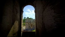 View of the Arch of Constantine framed by a window in the Colosseum