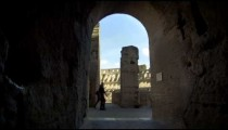 Slow motion footage from dark corridor in Roman Colosseum