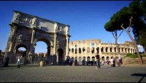Slow motion footage of the Arch of Constantine and Colosseum