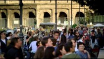 Slow motion shot of tourists outside of Colosseum