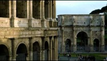 Shot of Arch of Constantine with Colosseum in the foreground.