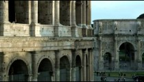 Panning shot close up of Colosseum to Arch of Constantine