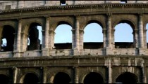 Close pan of arches in Roman Colosseum