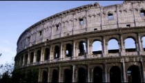 Left-to-right pan of tall side of Colosseum